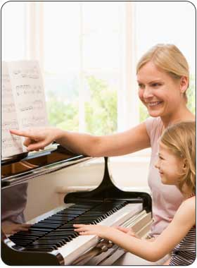 child enjoying advanced private piano lesson